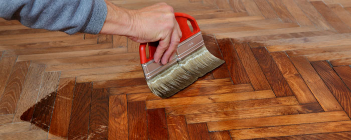 Applying varnish to hardwood - Varnishing Services